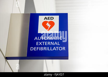 AED Automated External Defibrillator Sign at an airport. - Stock Photo