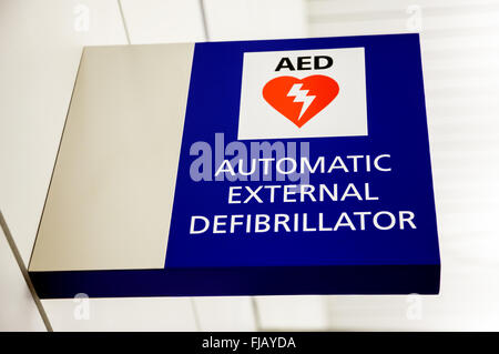 AED Automatic External Defibrillator Sign on a wall at an airport. - Stock Photo