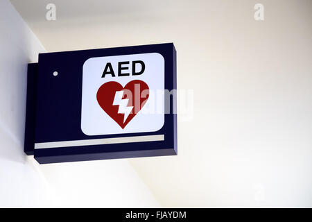 Automatic External Defibrillator AED Sign on a wall at an airport. - Stock Photo