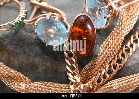 Set of various jewelry adornments on gray stone - Stock Photo
