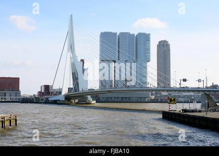 Nieuwe Maas river  with Erasmus bridge, Rotterdam, Netherlands, Behind 'De Rotterdam' skyscraper complex (Rem Koolhaas, - Stock Photo