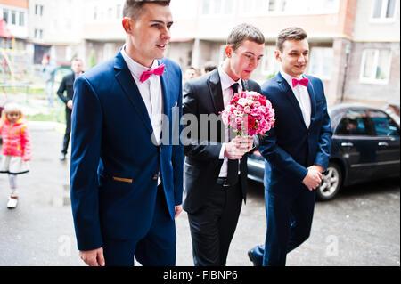 Groom with groomsman background wedding cars - Stock Photo