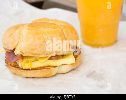 butter croissants, bacon and egg with orange juice - Stock Photo