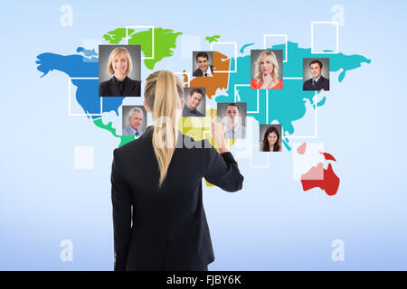 Composite image of business woman pointing somewhere - Stock Photo
