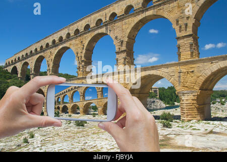 Taking picture of Pont du Gard (Provence, France) - Stock Photo