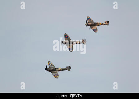 Three Supermarine Spitfire aircraft from the Royal Air Force, RAF, flight in formation, United Kingdom - Stock Photo