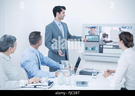 Composite image of screen with graphs - Stock Photo