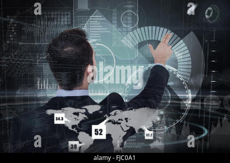 Composite image of businessman in suit  pointing these fingers - Stock Photo