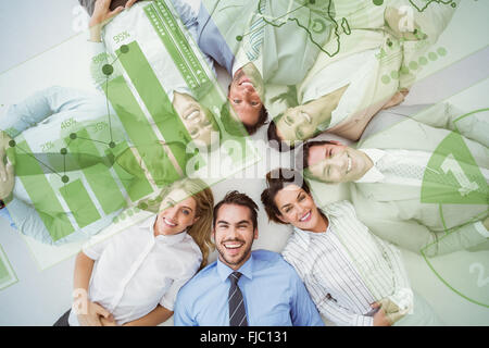 Composite image of young business people lying in circle - Stock Photo