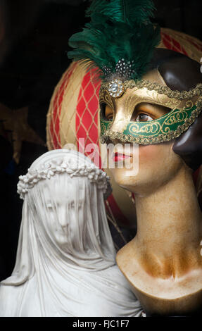Venetian mask on a manikin head and a Replica Veiled Maiden bust in the Scriptum shop window, Turl Street, Oxford, - Stock Photo