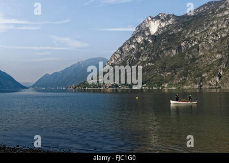 fishing boat on Lake Lugano,  Porlezza, Lombardy, Italy - Stock Photo