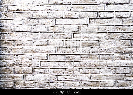 Light grey brick wall suitable for use as a background - Stock Photo