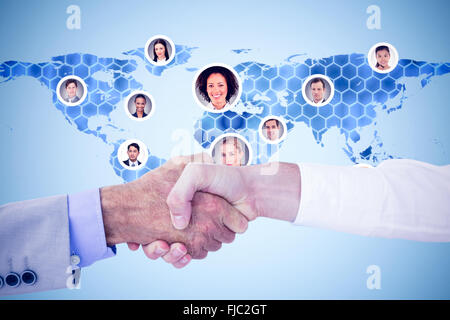 Composite image of business people shaking hands on white background - Stock Photo
