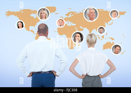 Composite image of  smiling business people with hands on the hips - Stock Photo