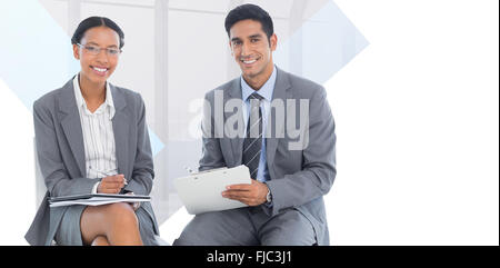 Composite image of portrait of smiling business people with paperwork - Stock Photo