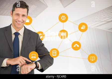 Composite image of businessman showing his watch - Stock Photo