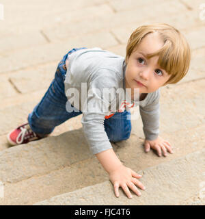 Cute boy climbing on stairs - Stock Photo