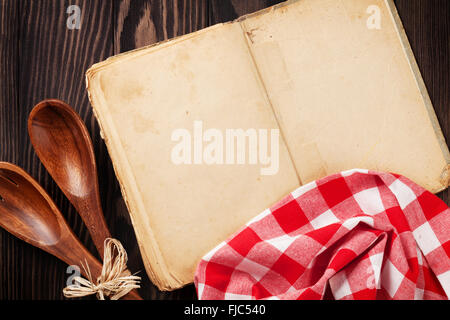 Blank vintage recipe cooking book and utensils on wooden table. Top view with copy space - Stock Photo