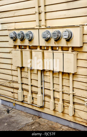 Electric Meters On Side of Old House Converted to Apartments - Stock Photo