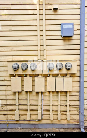 Electric Meters On Side of Old House - Stock Photo