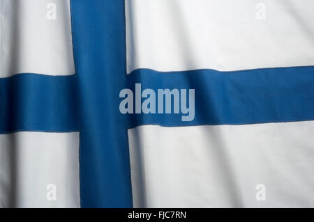 FINNISH FLAG MADE OF STITCHED COTTON BUNTING - Stock Photo