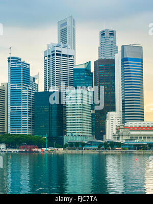 Singapore Downtown Core office buildings reflected in a river - Stock Photo