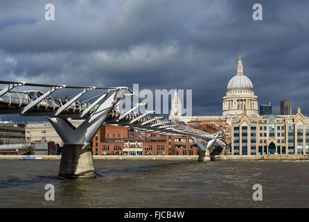 View of Millennium Bridge and River Thames looking towards St Paul's Cathedral, London, England, UK - Stock Photo