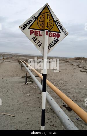 Gas pipeline -  Danger high pressure sign - Road Pueblo Nuevo to COLAN. Department of Piura .PERU - Stock Photo