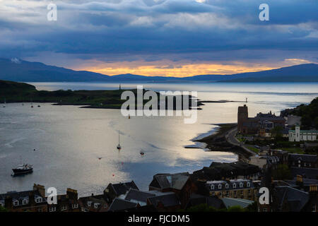 Sunset looking over Oban harbour - Stock Photo
