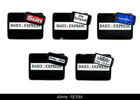The Daily Express newspaper logo on tablet screens surrounded by smartphones displaying the logos of rival newspapers. - Stock Photo