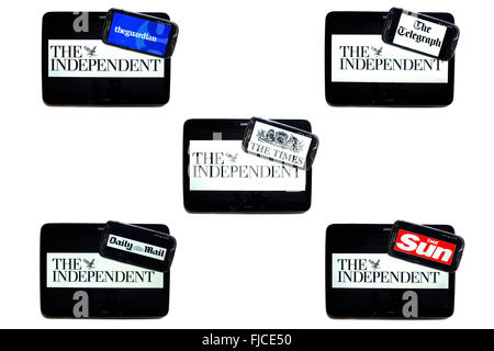 The Independent newspaper logo on tablet screens surrounded by smartphones displaying the logos of rival newspapers. - Stock Photo