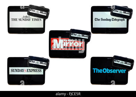 The Mail on Sunday newspaper logo on smartphone screens surrounded by tablets displaying the logos of rival Sunday - Stock Photo