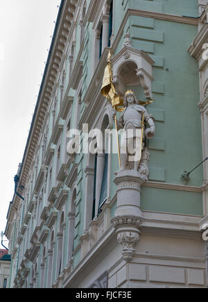 Old town architecture in  Graz, Styria, Austria. Statue on the house facade. - Stock Photo