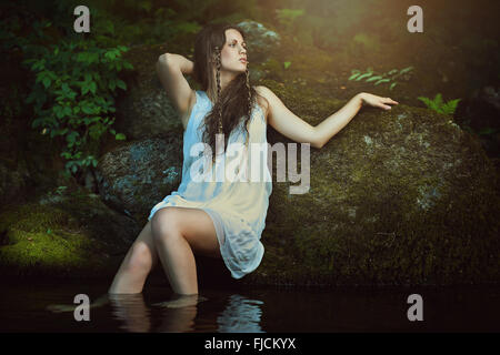 Beautiful nymph of the waters  posing in forest stream . Fantasy and surreal - Stock Photo