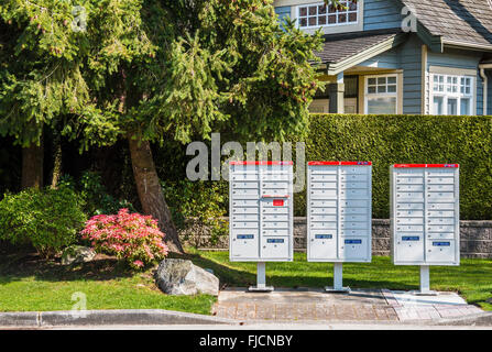 Modern Canada Post mailboxes in a residential area - Stock Photo