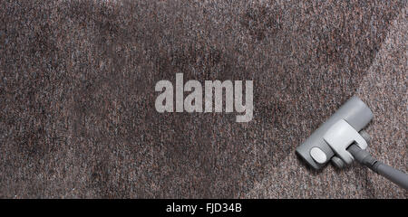 vacuuming very dirty and muddy carpet - Stock Photo