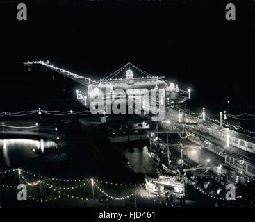1968 - Miles Of Lights At Southend: The wonderful display of light on the Pier at Southend which stretches from - Stock Photo