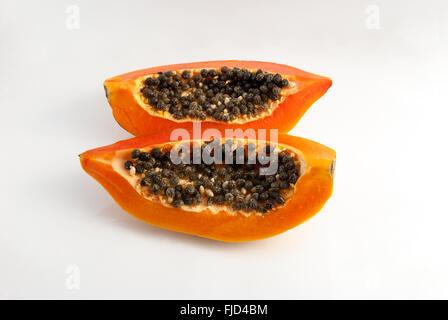 slices of fresh sweet papaya on white background - Stock Photo