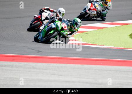 Misano Adriatico, Italy - June 21, 2015: Kawasaki ZX-10R of Pedercini Team, driven by CECCHINI Riccardo - Stock Photo