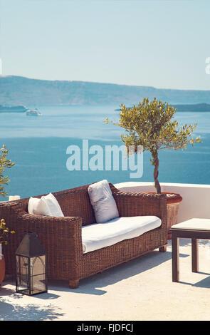 Image of a romantic patio with sea view. Santorini, Greece. - Stock Photo