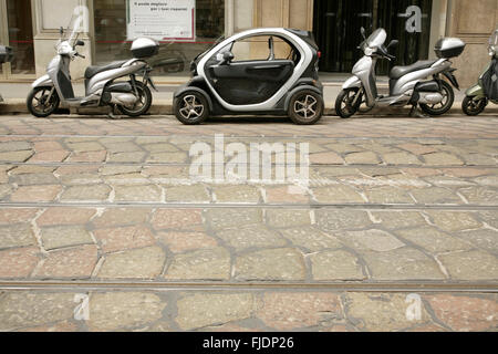 Electric Renault Twizy city car parked in Rome, Italy. - Stock Photo