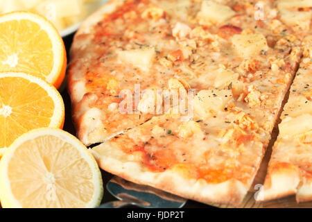 Exotic pizza with tropical fruit and chicken close up. Shallow depth of field.