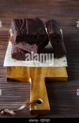 Brownie on a cutting board, food closeup - Stock Photo
