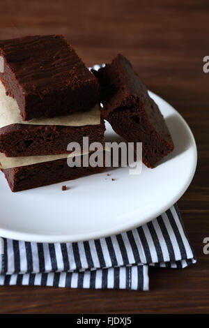 Brownies slice on plate, food closeup - Stock Photo