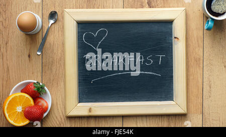 Love breakfast written on a chalkboard - Stock Photo