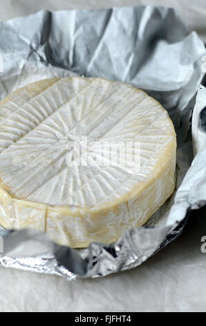 Whole round camembert cheese, close up shot - Stock Photo