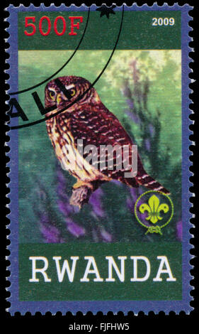 BUDAPEST, HUNGARY - 01 march 2016:  a stamp printed by Rwanda, shows Owl, circa 2009 - Stock Photo