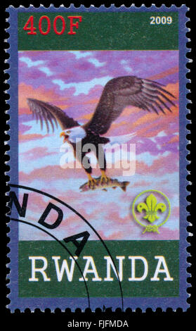 BUDAPEST, HUNGARY - 01 march 2016:  a stamp printed by Rwanda, shows Eagle, circa 2009 - Stock Photo