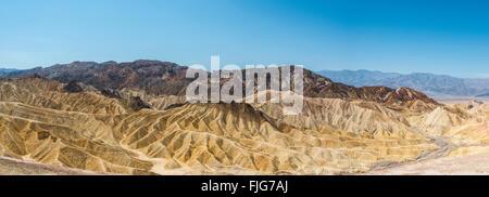 Panoramic view, Badlands, Zabriskie Point, Panamint Range behind, Death Valley National Park, California, USA - Stock Photo