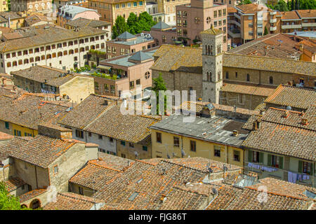 View on an Italian town in Tuscany with its typical terracotta roofs - Stock Photo